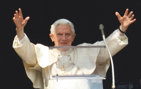 Pope Benedict greets the crowd before beginning Angelus today. (CNS/Paul Haring)