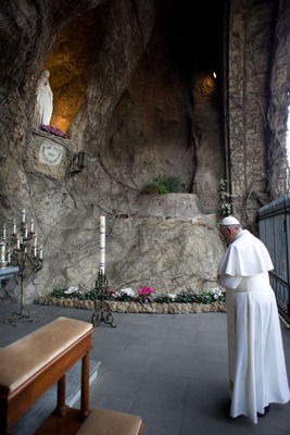 Pope Francis prays at Lourdes Grotto in the Vatican Gardens March 16. (CNS photo/L'Osservatore Romano)