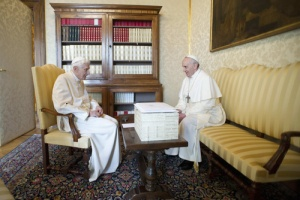 Pope Benedict XVI talks with Pope Francis at the papal summer residence in Castel Gandolfo. (CNS//L'Osservatore Romano via Reuters)
