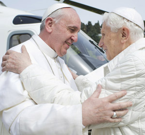 Pope Francis embraces retired Pope Benedict XVI at the papal summer residence in Castel Gandolfo. (CNS/L'Osservatore Romano via Reuters)