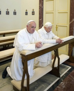 Pope Francis prays with  Pope Benedict after arriving at the papal summer residence in Castel Gandolfo. (CNS/L'Osservatore Romano via Reuters)