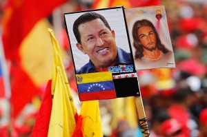 Images of  Venezuelan President Hug Chavez held up at a recent rally in Caracas. (CNS photo/Reuters)