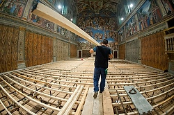 Worker prepares Sistine Chapel for conclave. (CNS photo/L'Osservatore Romano)