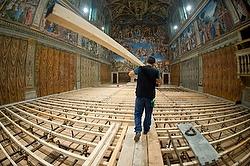 Worker prepares Sistine Chapel for conclave. (CNS photo/L'Osservatore Romano)