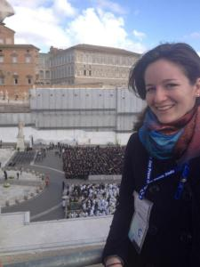 Lauren Colegrove enjoying a beautiful morning on top of the colonnade surrounding St. Peter's Square during the installation Mass of Pope Francis. (CNS photo courtesy of Danielle McMonagle)