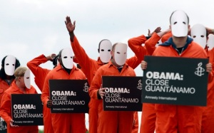 Masked activists from Amnesty International dressed as Guantanamo Bay detainees protest in Belfast Northern Ireland ahead of the Group of Eight Summit in mid-June. (CNS/Reuters)