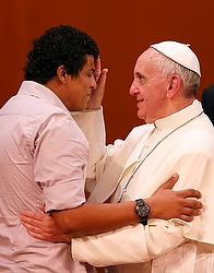 Pope Francis blesses Walmyr Junior, 28, during a meeting with political, economic and cultural leaders at Municipal Theater in Rio de Janeiro July 27. The young man, who overcame drug abuse and is now a youth minister, shared his story of life transform ation -- his discovery of a loving God and church. (CNS photo/Paul Haring)