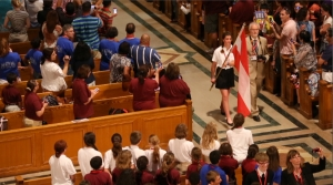 Flag procession down center aisle of national shrine opens choir festival. (CNS photo/Tyler Orsburn)
