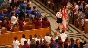 Flag procession down center aisle of national shrine opens choir festival. (CNS photo/Tyler Orsburn)
