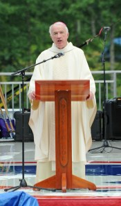 Bishop Michael J. Bransfield of Wheeling-Charleston, W.Va., preaches from a special podium created for Scout jamboree Mass. (Photo courtesy of Edward Bronson, Boy Scouts of America)