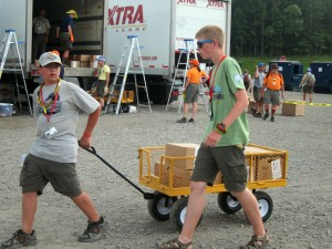 Cart pullers take breakfast and dinner to camspite at Scout jamboree. (Photo courtesy Msgr. John B. Brady)