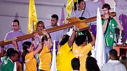 Young people carrying the World Youth Day cross at the opening ceremony last night. (CNS/Paul Haring)