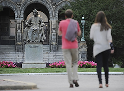 Two women walking on the campus of Georgetown University in Washington June 14 pass a statue of Archbishop John Carroll, Baltimore's first archbishop and founder of Georgetown.