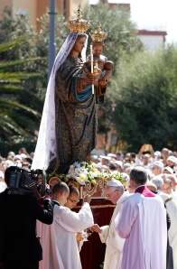 Pope prepares incense as he venerates statue during Mass at Sanctuary of Our Lady of Bonaria in Cagliari