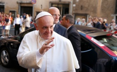 Pope greets crowd as he arrives to celebrate private Mass at Church of the Gesu in Rome