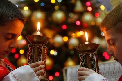 IRAQI BOYS PRAY FOR PEACE DURING MASS AT CHALDEAN CHURCH IN JORDAN