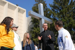 Chaplain chats with student outside chapel at Pennsylvania Catholic university