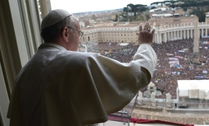 Pope Francis waves as he leads his first Angelus in St. Peter's Square at Vatican