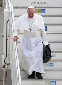 Pope Francis steps off a plane in Rome, returning from his trip to Brazil