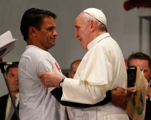 Pope greets man as he meets with patients, others at hospital in Rio