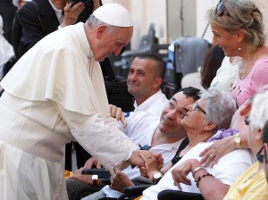 Pope greets people in wheelchairs after celebrating Mass in St. Peter's Square at Vatican