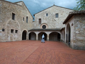 Nun walks courtyard of San Damiano in Assisi