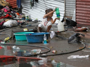 Girl transfers drinking water she collected after super typhoon hits Philippines