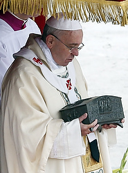 Pope Francis holds reliquary containing relics of Apostle St. Peter during Mass in St. Peter's Square at Vatican