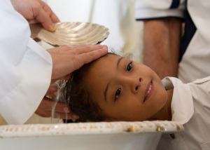 CUBAN GIRL IS BAPTIZED AT SHRINE OF OUR LADY OF EL COBRE