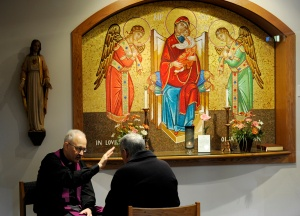 Priest hears a confession during diocesan-wide Day of Penance at New York church