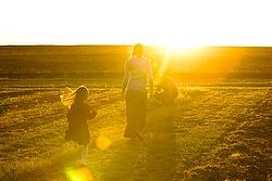 Kansas farming couple checks soil (CNS photo/Tyler Orsburn) check quality of soil in