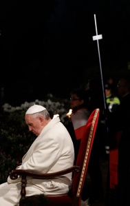 Pope Francis prays during Good Friday Way of the Cross at Colosseum