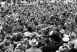 President Kennedy reaches out to crowd outside Texas hotel in 1963 CNS photo/Cecil Stoughton, courtesy John F. Kennedy Presidential Library and Museum)