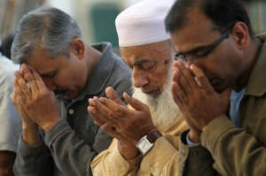 MEN PRAY AT ISLAMIC CENTER IN NEW YORK