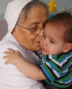 NUN COMFORTS CHILD AT CRECHE FACILITY FOR ABANDONED CHILDREN IN BETHLEHEM