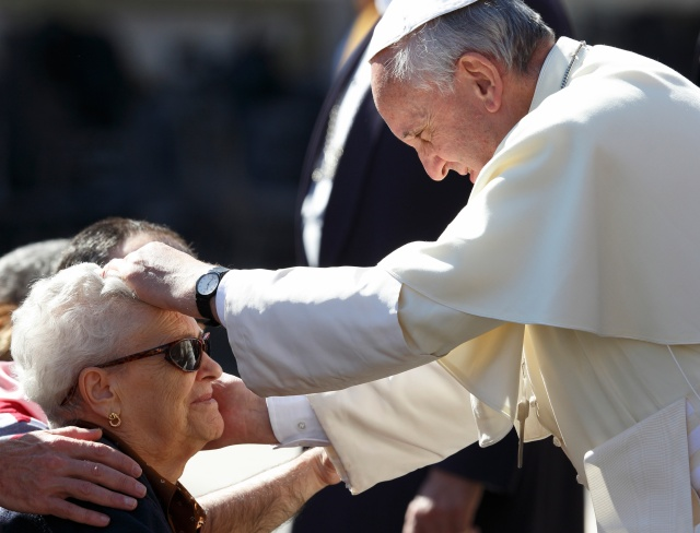 Pope greets woman during general audience in St. Peter's Square at Vatican