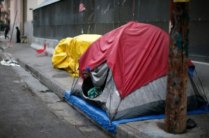 Man wakes up after sleeping in tent on street in downtown Los Angeles