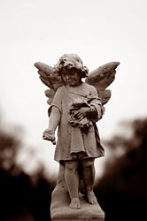Child angel on tombstone (CNS photo by Bob Roller)