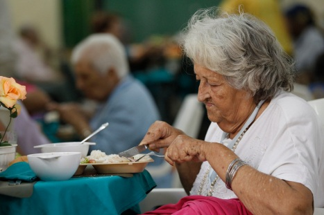 WOMAN DINES AT CHURCH-BASED CENTER FOR ELDERLY IN HAVANA