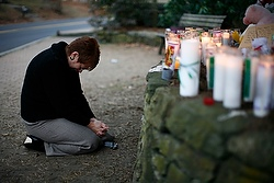 Woman at memorial near Sandy Hook Elementary School in Newtown, Conn., Dec. 16, 2012. (CNS photo from Reuters)