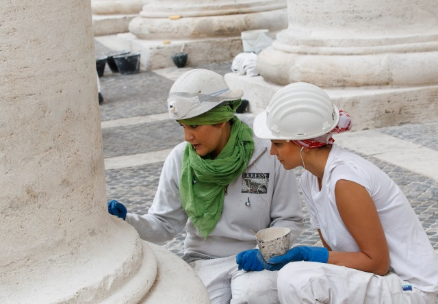 WORKERS PREPARE TO FILL PITTED AREAS OF COLONNADE AT VATICAN