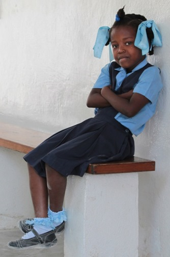 A girl sits outside a classroom at St. Anthony of Padua Church in the rural community of Petite Riviere des Nippes, Haiti, in this March 2011 photo. CNS/Bob Roller