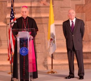 Archbishop Dominique Mamberti, Vatican foreign minister, and Ken Hackett, U.S. ambassador to the Holy See, speak in the Palazzo della Cancelleria. (CNS/Alessandro Corradini, courtesy of the U.S. Embassy to the Holy See)
