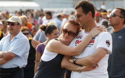 COUPLE EMBRACE DURING WORLD MEETING OF FAMILIES IN MILAN