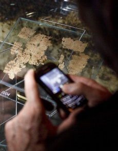 VISITOR TAKES PHOTOS OF ANCIENT FRAGMENTS OF NEW TESTAMENT IN 'VERBUM DOMINI' EXHIBIT AT VATICAN