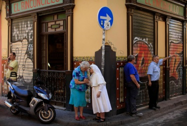 Nun chats with a woman in Spain