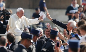 Pope accepts letter as he arrives to lead general audience in St. Peter's Square at Vatican