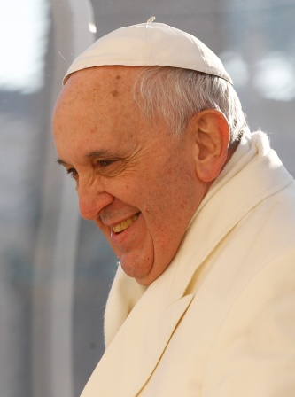 Pope smiles as he arrives to lead general audience in St. Peter's Square at Vatican