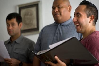Seminarian laughs during chorus rehearsal at Hispanic seminary in Mexico City