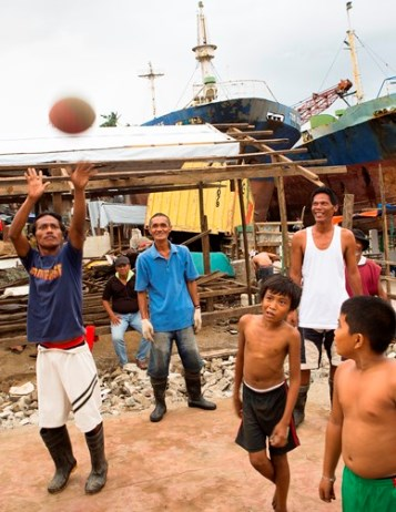 Residents of Tacloban, Philippines, shoot some hoops. (CNS/Tyler Orsburn)
